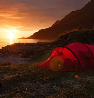 red-tent-bikes-waterfront-norway-sunset_h